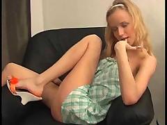 Blonde teen strips and masturbates