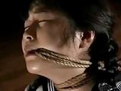 Tied Asian uniform girl