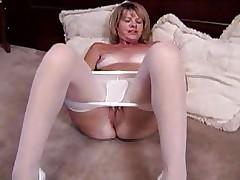 Blonde mature masturbates in white pantyhose