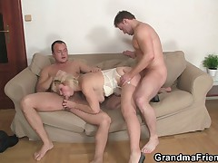 Mature widow enjoys two fresh young cocks