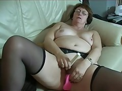 Granny in Glasses and Stockings with Two Toys